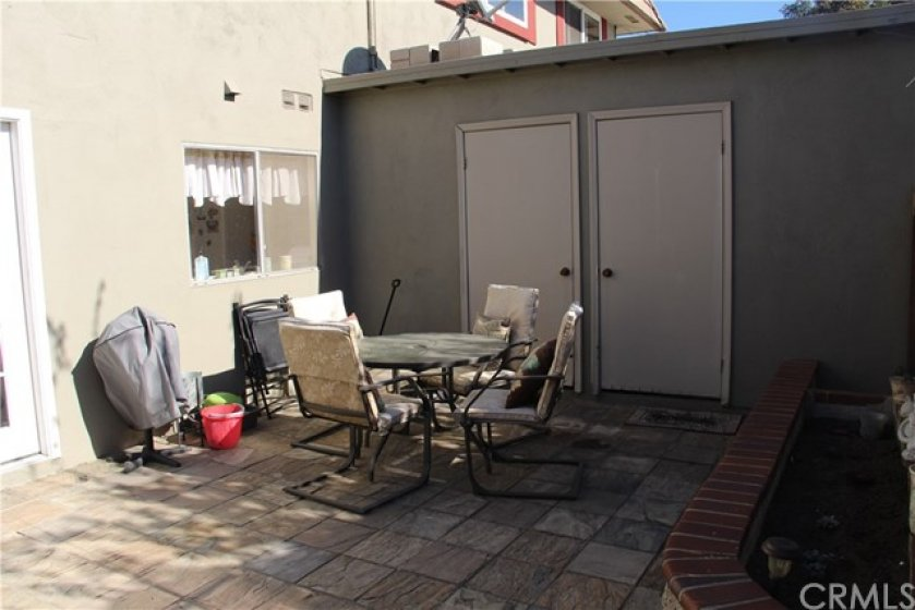 Private Back Yard with 2 Storage Closets