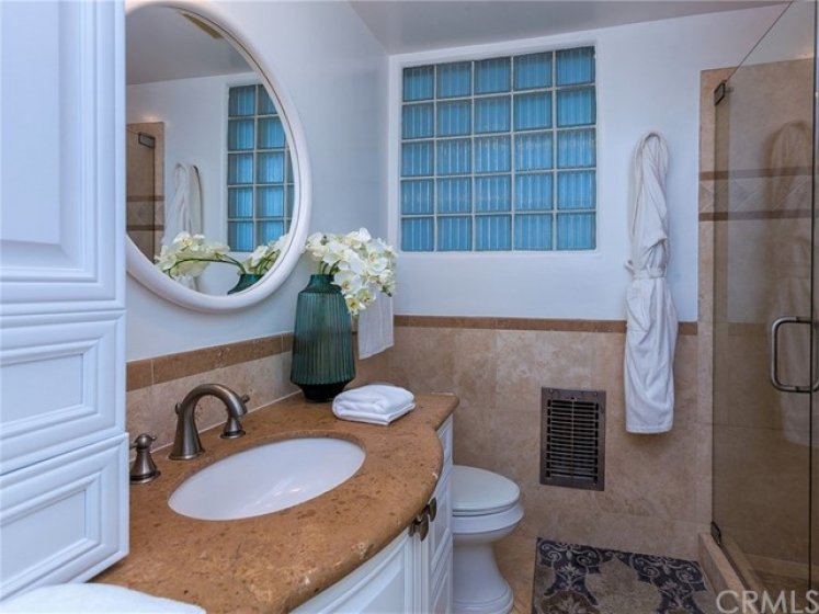 Master bathroom features a separate stone-tiled shower