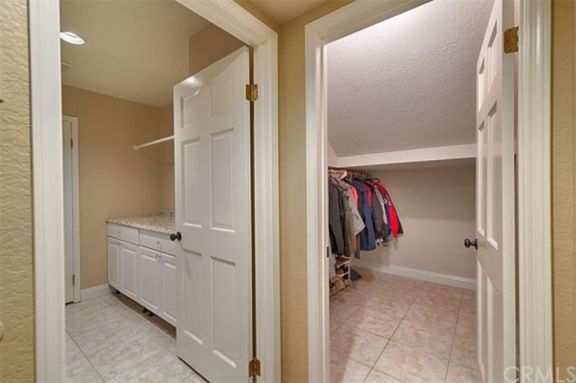 Huge storage and coat closet, next to the laundry room.