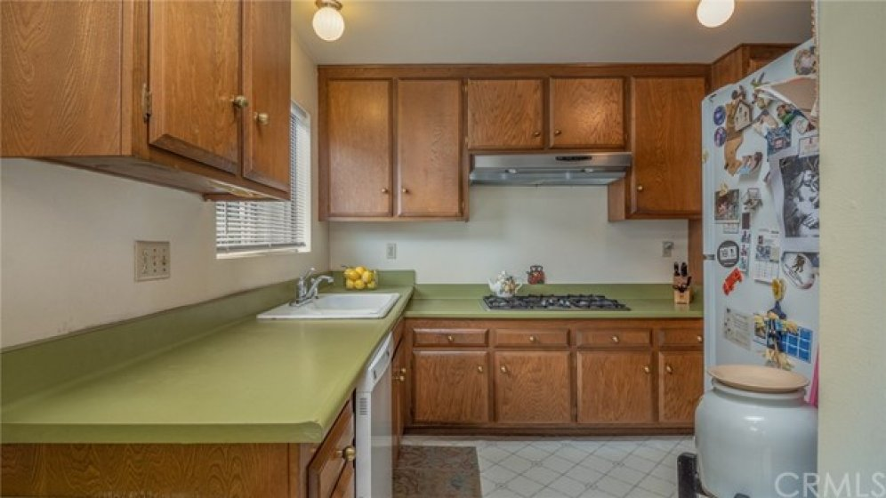 With lots of storage, solid cabinets, 5-burner gas stove top, and original formica countertops, this kitchen is just waiting for someone who loves to cook.
