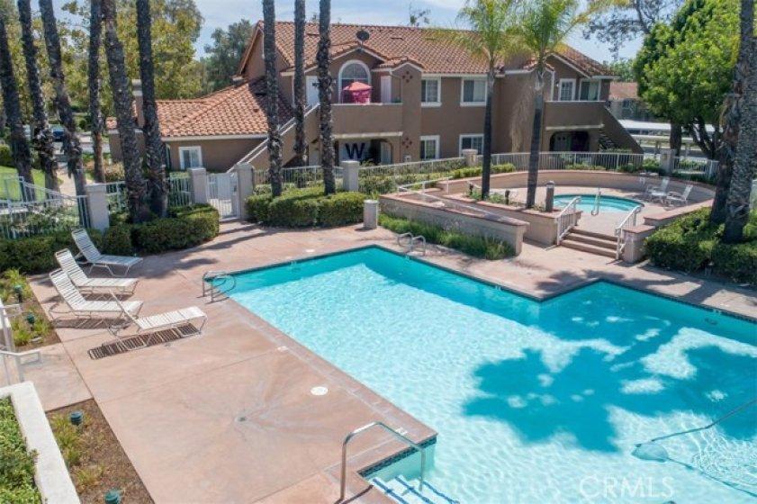 refreshing pool, beach chairs, and spa