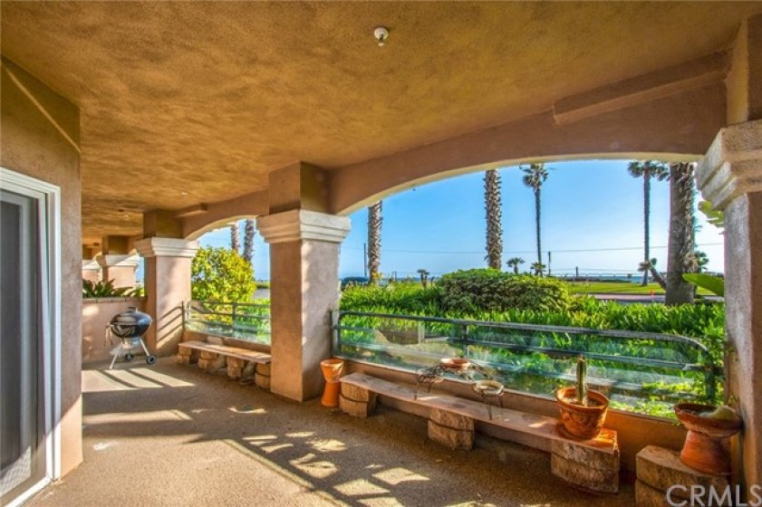 WHAT A LOCATION!.  Back patio off of living area w/so much room to entertain and enjoy the OCEAN VIEWS
