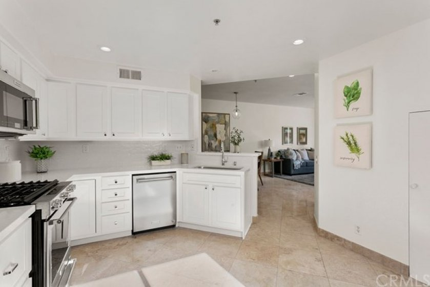 Bright white cabinets and quartz cabinets have just been added to this remodeled home.