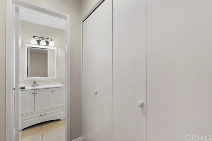 Laundry nook/closet next to downstairs bathroom