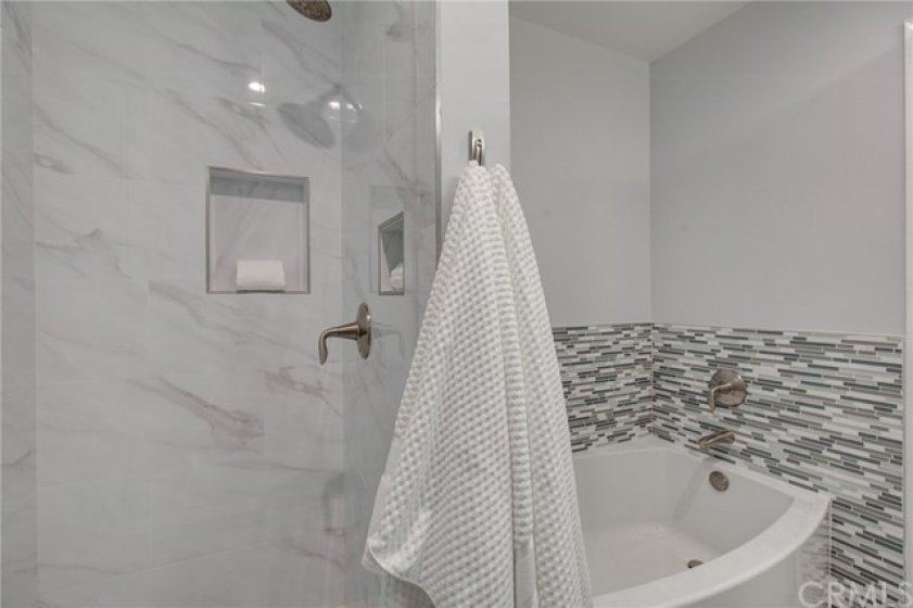Separate shower and soaking tub off of additional bedrooms.