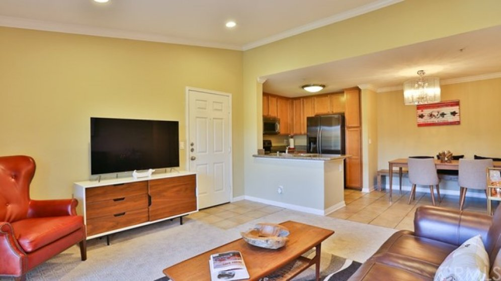 This space features recessed lighting, high ceilings, & crown molding