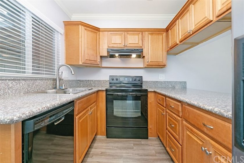 Remodeled kitchen with maple cabinets, granite counter tops and recessed lighting