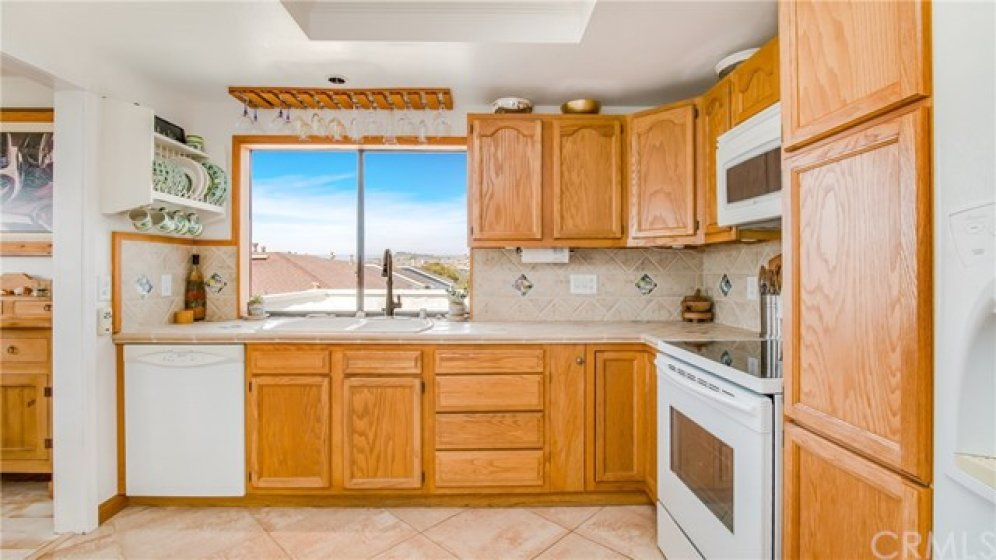 Ample cabinets, with pull out shelves, lazy susan and large pantry.