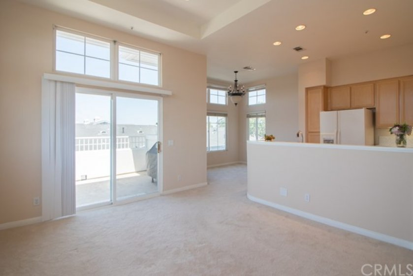 View from fireplace of dining area and kitchen