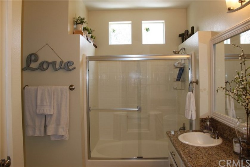 Tub and shower enclosure