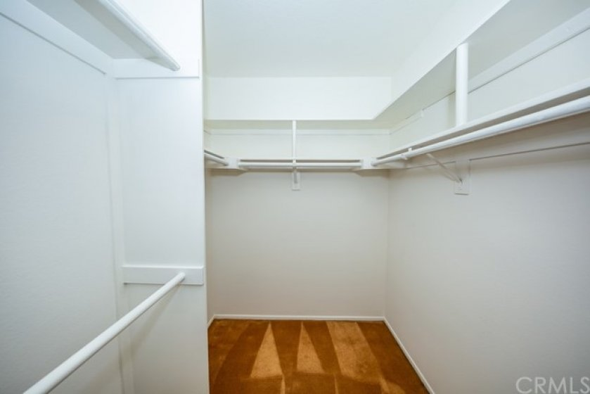 Walk-in closet in the master bedroom with lots of room.