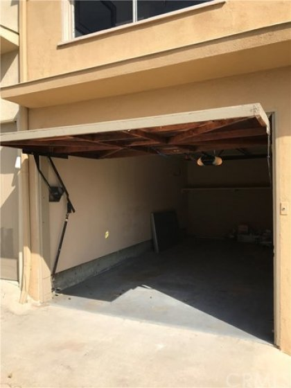 Left view of garage, with window screens for the condo at left on the rear.  This is a very rare quality in condos in the heights and shores.  Parking that nobody else can beat you to :)))