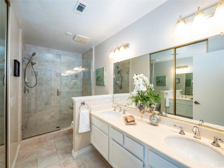 Amazing Master Bathroom with huge Walk-in Shower, Dual Vanities & Upgraded Lighting. Huge Walk-in Closet across from Sink