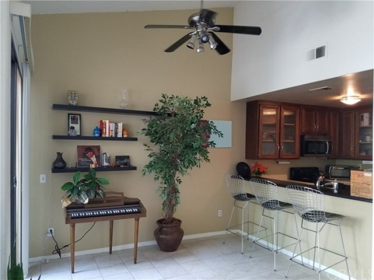 Large Dining area, used as Music space now. Check out the volume ceiling and fan too!