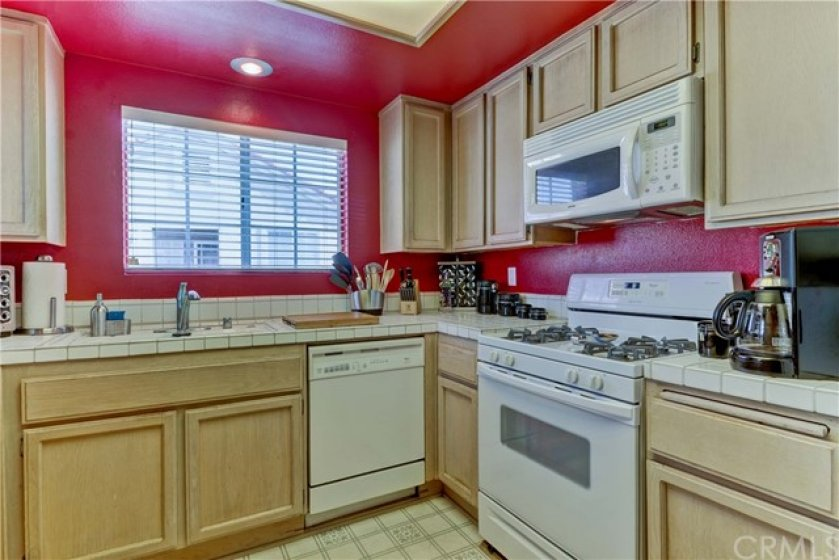 Kitchen provides a microwave, dishwasher and gas stove.