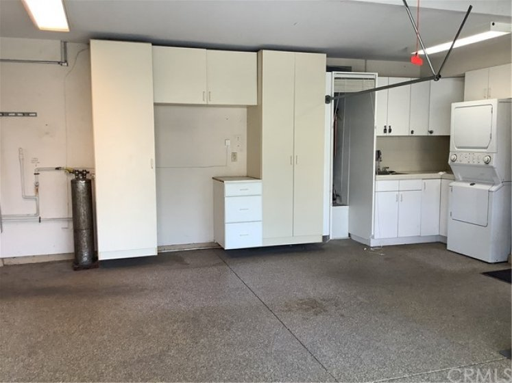 Storage cabinets, utility sink, and washer dryer hook ups