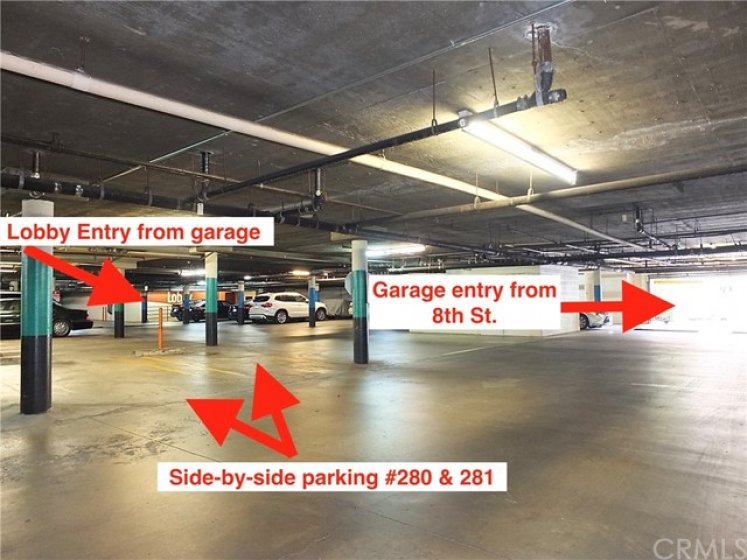 Amazing side-by-side parking spaces, conveniently located near garage entry and lobby.