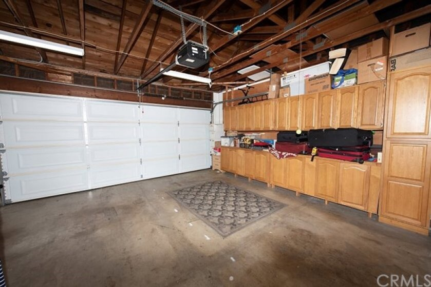 Garage with Customized Storage Cabinets