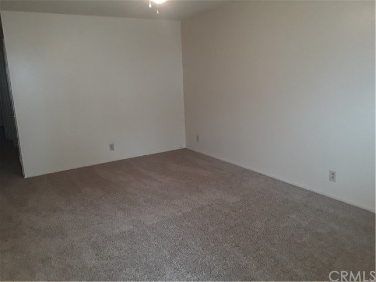 Freshly painted interior, new carpeting, ceiling fans through out.