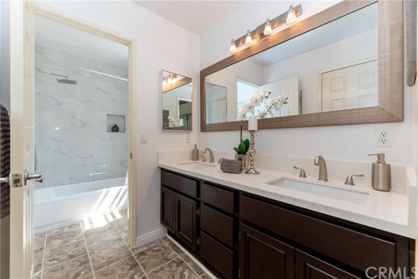 Double sink with quartz counters and new bathroom fixtures