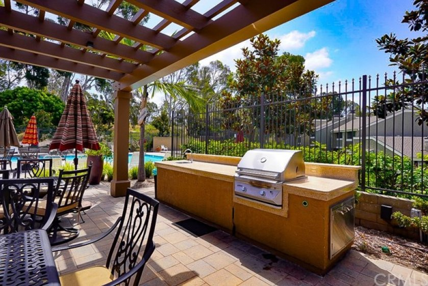 Ample outdoor cooking areas poolside !