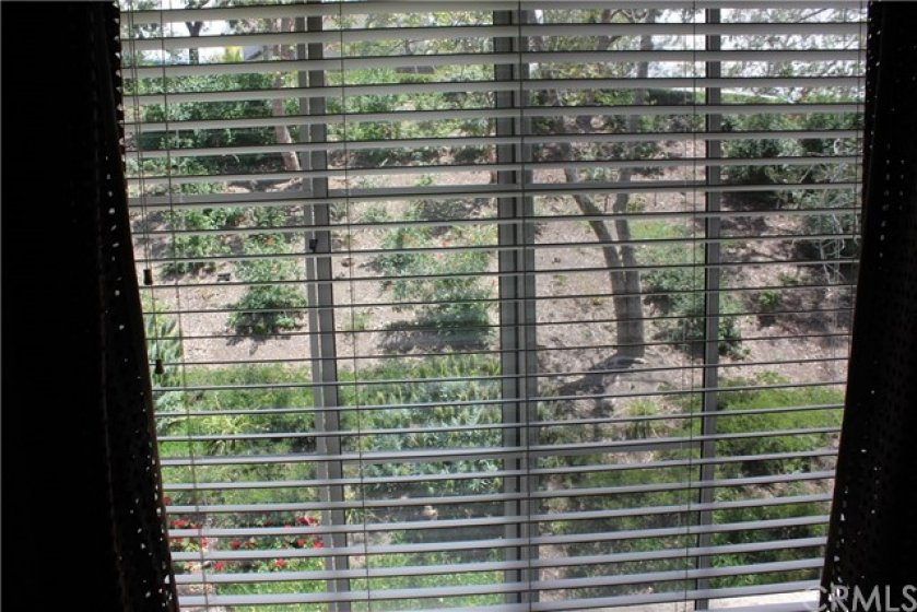 PREMIUM LOCATION!!!!!!!! View of homeowners association maintained greenbelt/slope with trees from upstairs bedrooms.