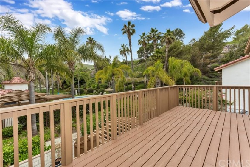 Upstairs patio located off the Master bedroom. Enjoy your morning coffee or a glass of wine in the evening. Plenty of room for an additional outdoor living area. Great view of the pool, tennis courts and lush vegetation.