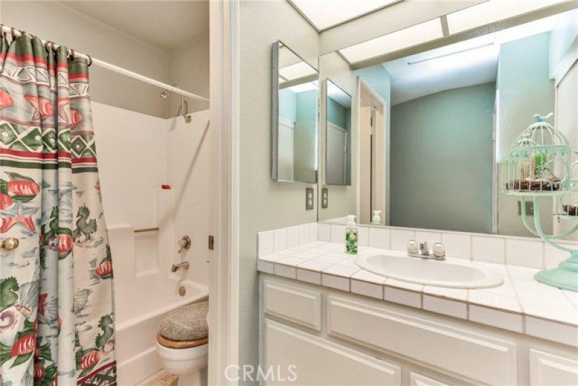 Full upstairs bathroom. Shower/tub and single sink, tile top vanity. Large walk-in closet.