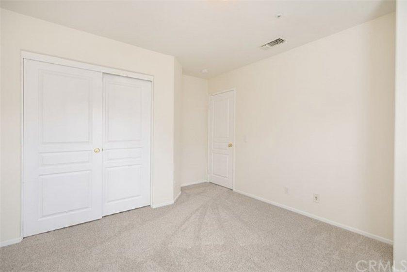 Bedroom #3 closet and brand new carpet.