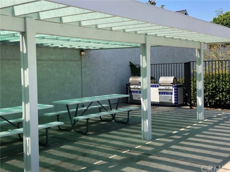Private covered BBQ area for extended family and friends to celebrate your new home.