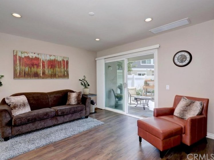 The living room opens to the back patio, a second outdoor area to unwind or have fun.