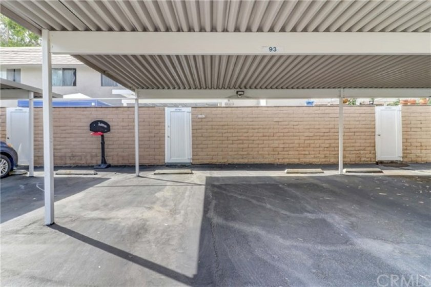 2 assigned parking spaces are covered by a carport directly behind your back gate for easy access.