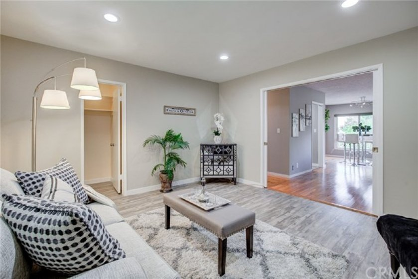 Family room with closet has double pocket doors and could be made private as an office or guest room.