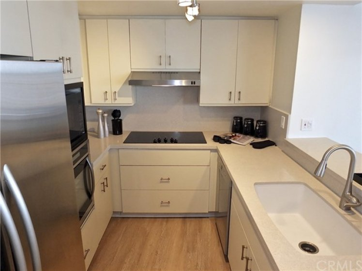 Classic cabinetry with new appliances and beautiful quartz counter tops, new sink and fixtures.