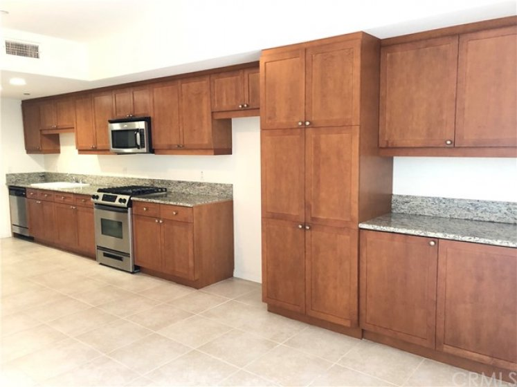 Granite counter tops, stainless steel appliances, custom cabinetry and tile flooring.