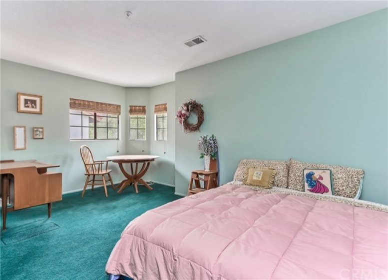 Upstairs spacious second bedroom with retreat area. Custom window coverings. Nice natural light.