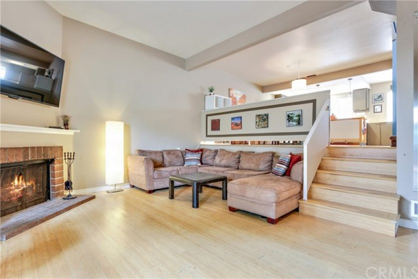 The fireplace is the focal point of the living room.