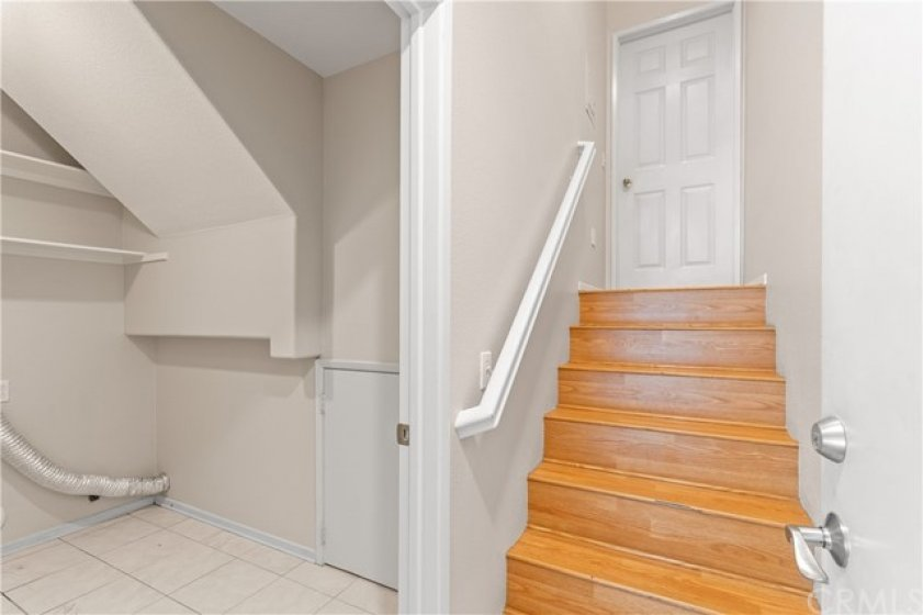 Stairs to garage and laundry area