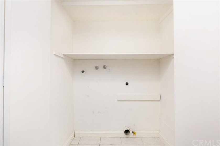 full size washer/dryer in closet at base of stairs.