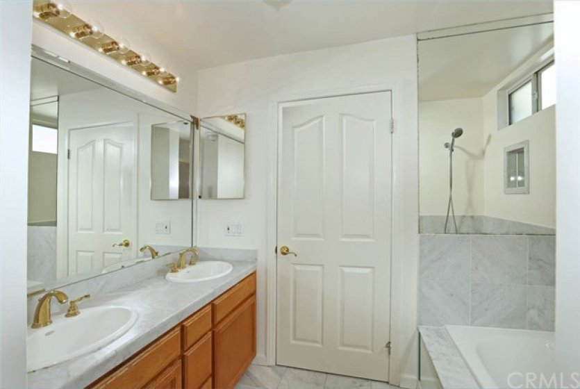Master bathroom with double sinks, jacuzzi tub and separate shower