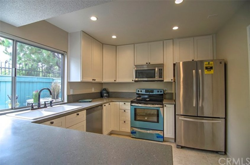 Beautiful Remodeled Kitchen with Stainless Appliances