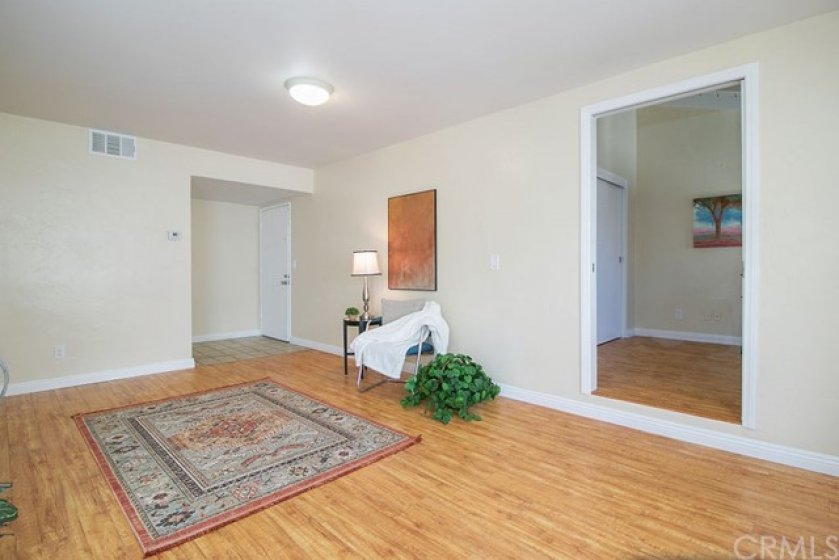 As we make our way back to the living room we see a open doorway that leads to the second bedroom.