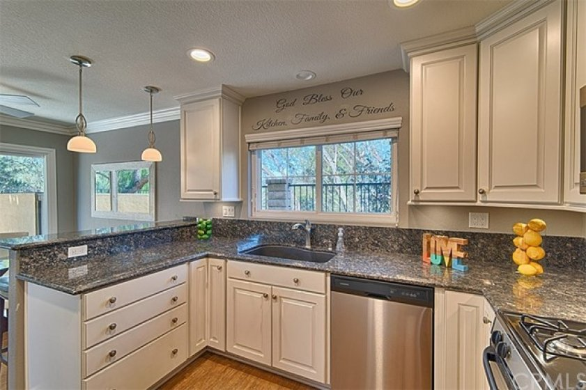 Above the kitchen sink is a window to look at all the beautiful mature green trees.