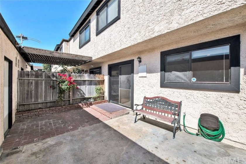 Private enclosed Patio/yard space. Ready for a BBQ? Connects to 2 car garage.