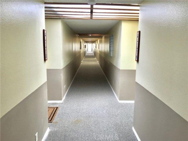 hallway leading to front door, located on 2nd floor