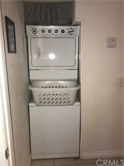 Washer and Dryer Unit in Hall