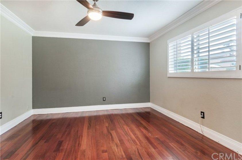 Master bedroom has plantation shutters.