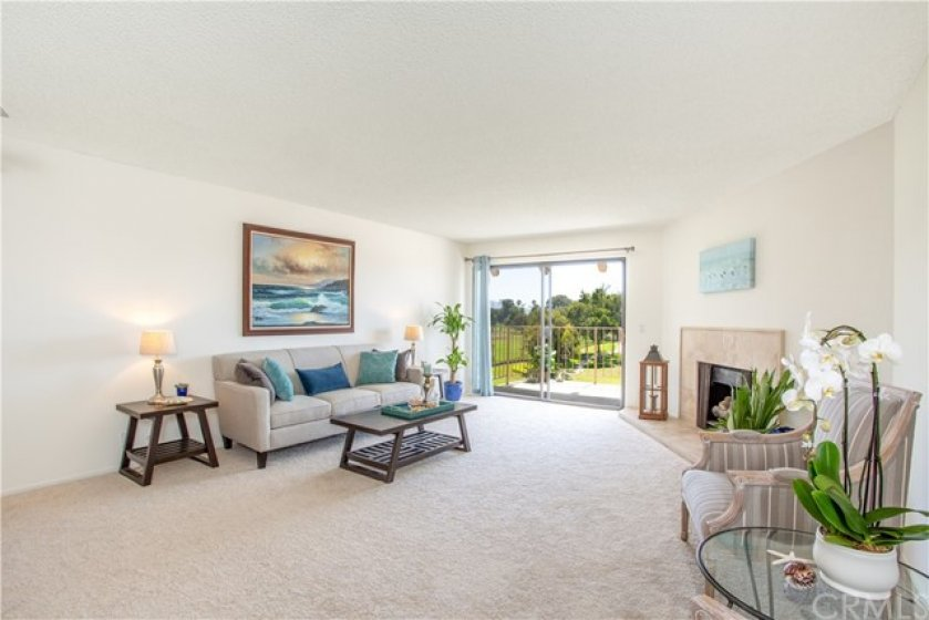 Morning sunshine, golf course and ocean views from your living room