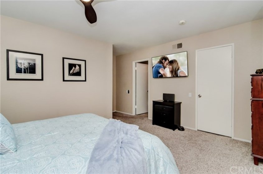 MASTER BEDROOM WITH LARGE WALK IN CLOSET AND BATHROOM.