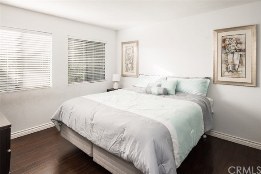 Large Master Bedroom with High Grade Wood Flooring